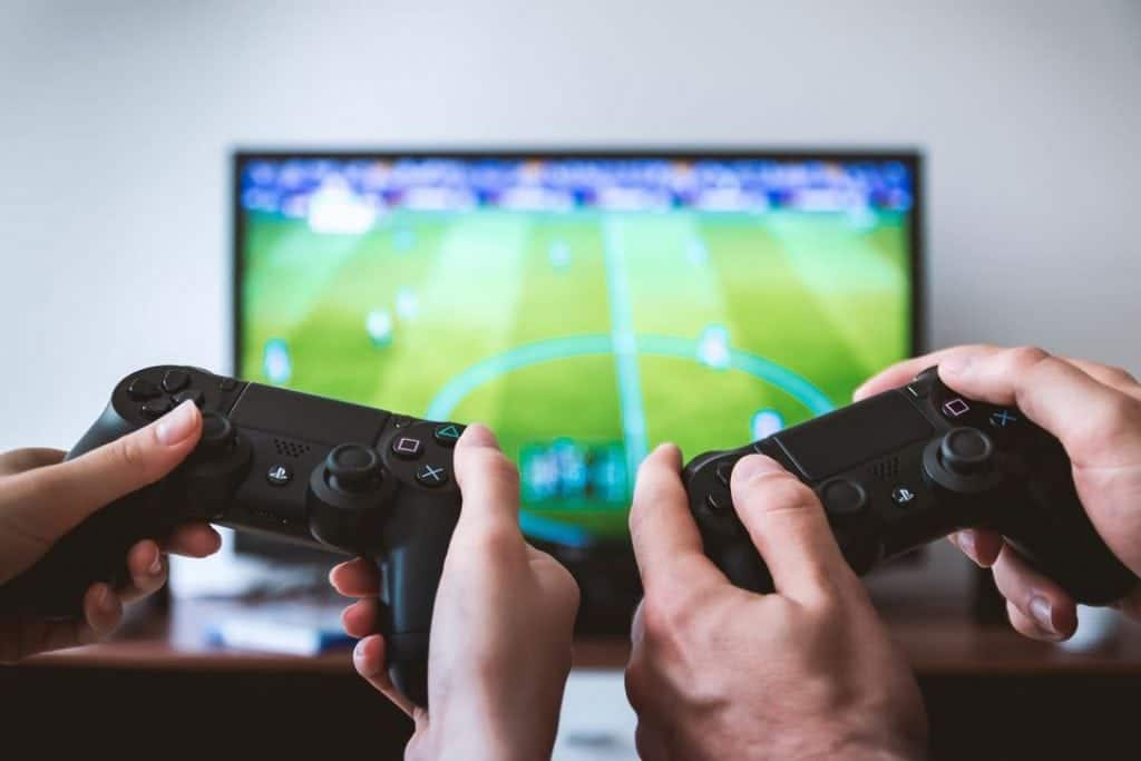 Picture of two people playing a soccer video game