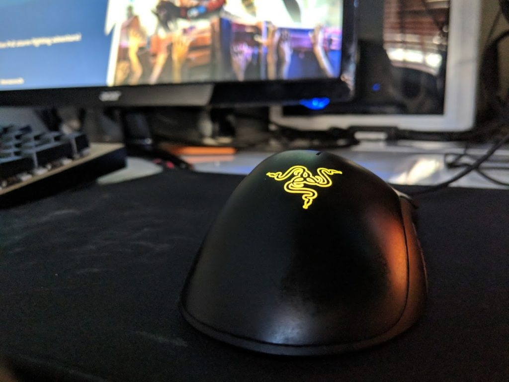 Black gaming mouse with yellow emblem