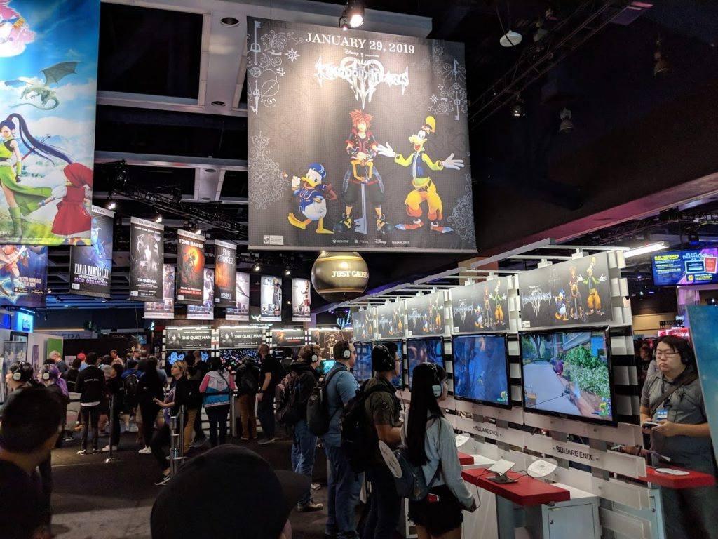 Picture of a large gaming conference with attendees playing video games